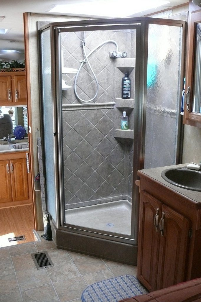 Having the Girard Systems tankless hot water heater installed as an after market product in your trailer will provide you with unlimited hot water. No more military showers.