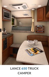 The interior offers everything you would have in a travel trailer including a wet bath.